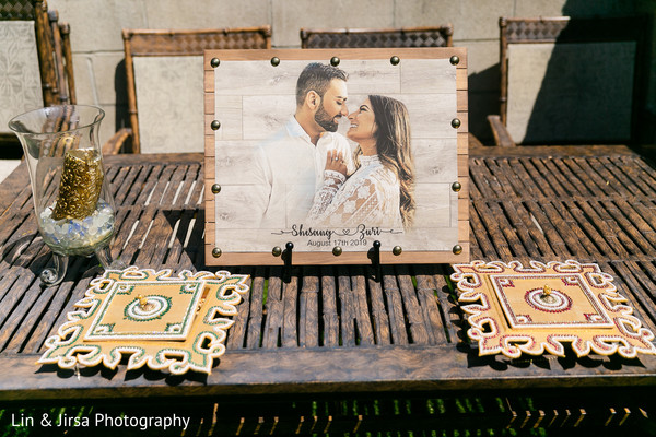 A table decorated with a picture of the Indian couple