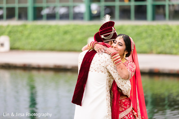 Indian couple hugging in their wedding attires