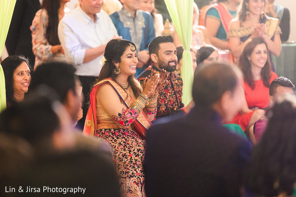 Joyful indian couple at their pre-wedding party.