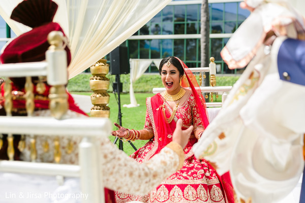 Indian bride and Indian groom greeting each other