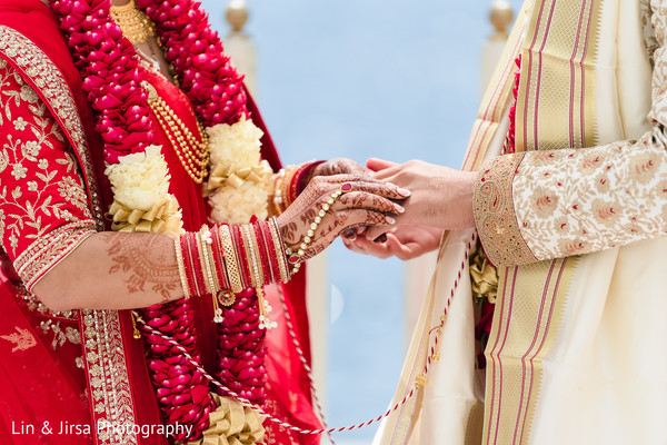 Indian bride putting the ring to groom.