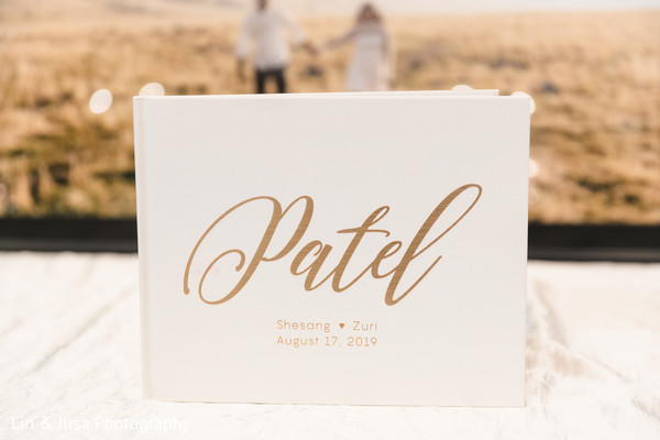Ivory with golden personalized names for Indian wedding guest book.