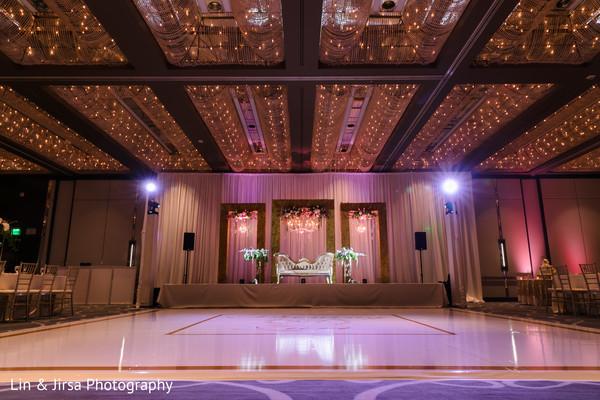 Golden and purple Indian wedding reception lights decoration.