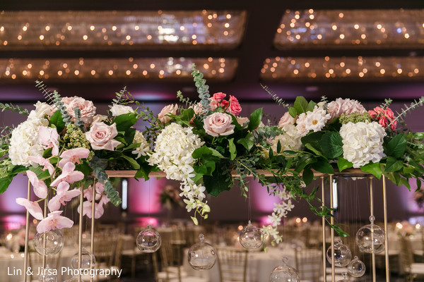 Pink, white and green Indian wedding table flowers centerpiece.