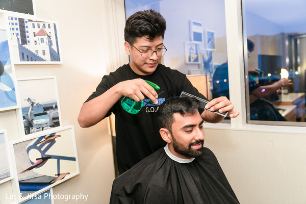 Indian groom getting a haircut before the wedding.