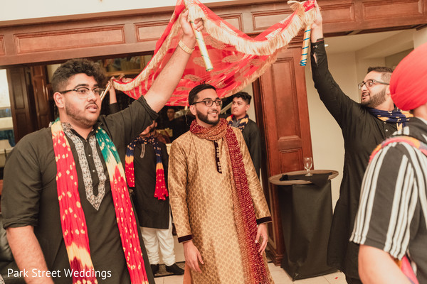 Indian groom making his entrance to pre-wedding party.