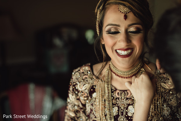 Indian bride getting her golden necklace on.