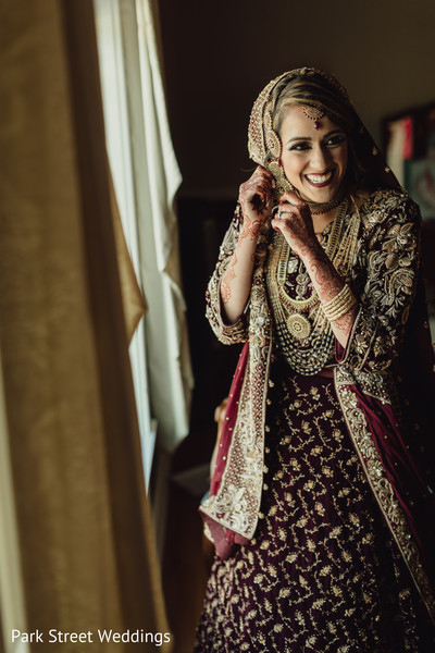 Indian bride getting ready for Indian wedding ceremony.