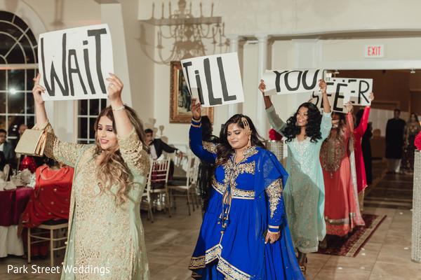 Indian bridesmaids announcing maharani's entrance.