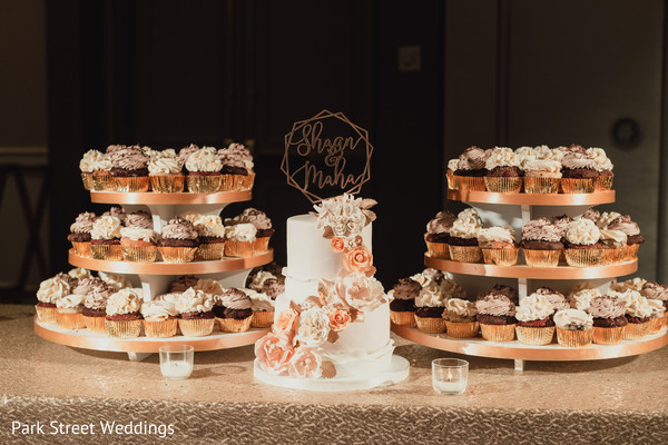 Cupcakes and cake for Indian wedding reception party.