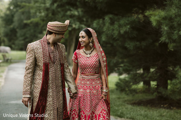 Indian couple walking together while holding hands.