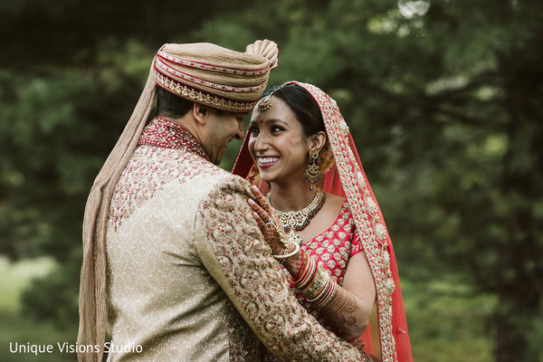 Indian couple looking at each other for photo shoot.