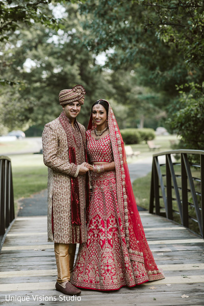 Indian couple holding hands on the bridge.