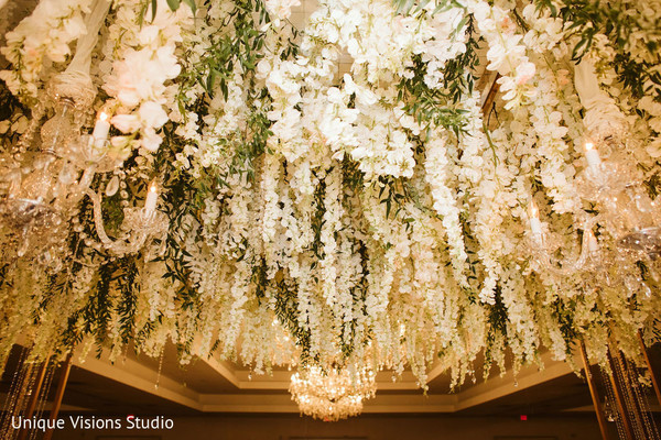 Venue's roof decorated with hundreds of flowers.