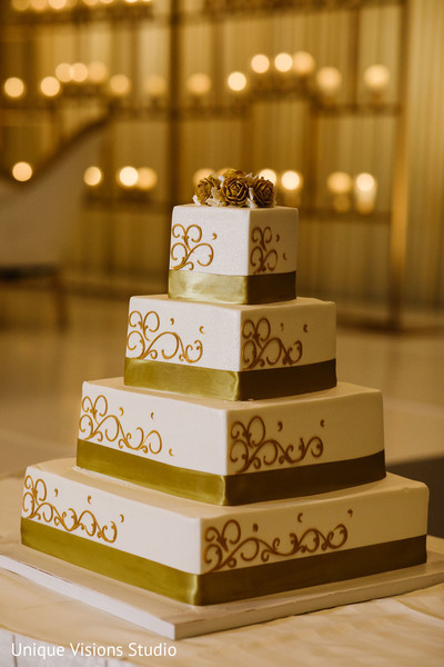 Wedding cake decorated with golden details.
