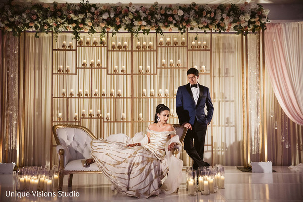 Indian couple in formal wear posing for picture.