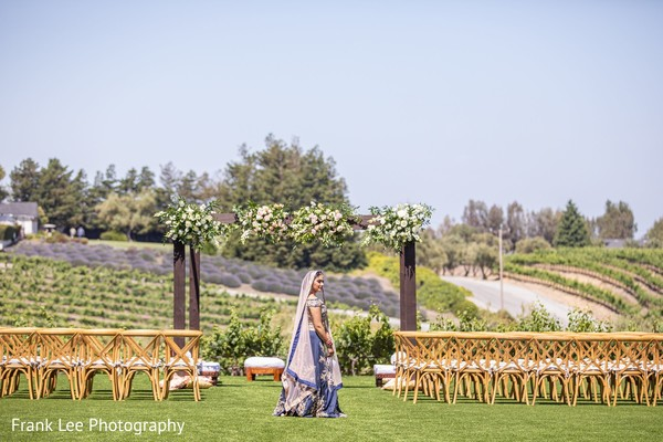 Indian bride on her ceremony blue lehenga.
