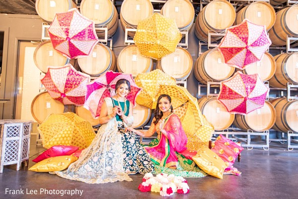 Indian brides with umbrellas