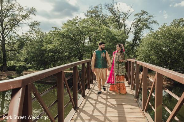 Indian couple holding hands on woodbridge