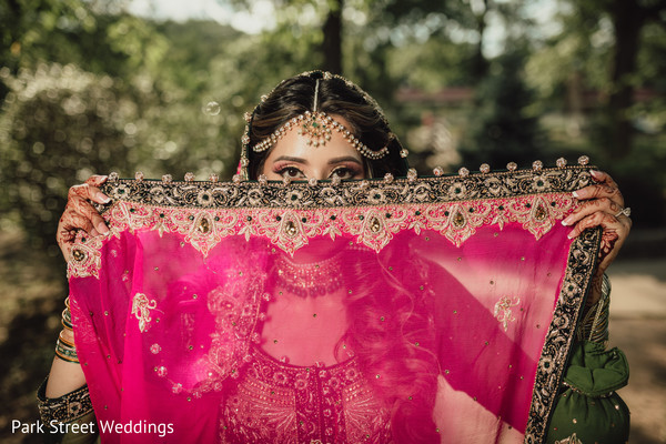 Pink veil indian bridal covering mouth