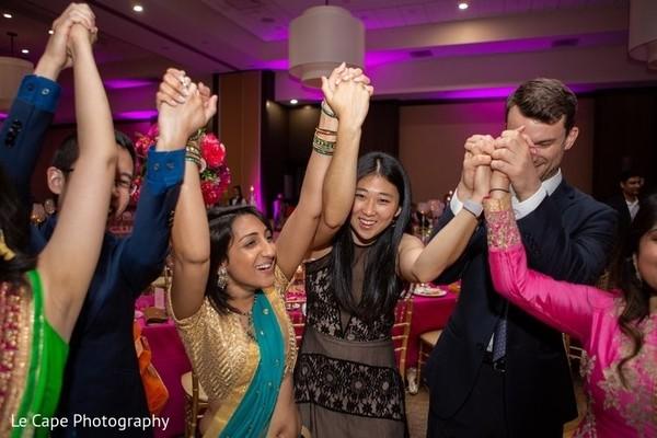 People celebrating on indian wedding