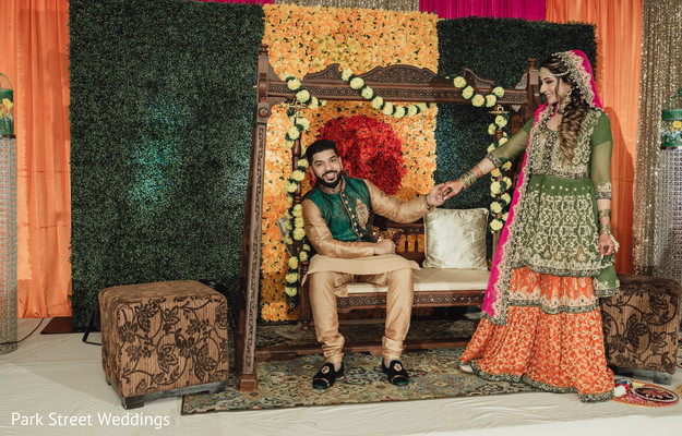 Indian couple in colorful wedding stage