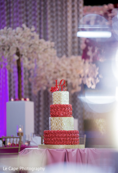 Red and golden Indian wedding cake decoration.