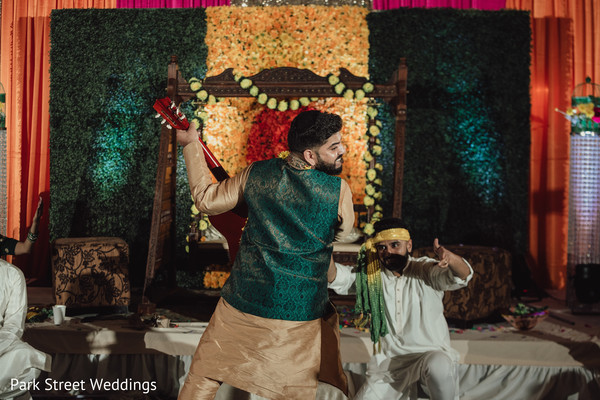 backwards Indian groom playing guitar