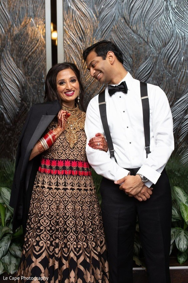 Indian couple on their wedding reception outfits.