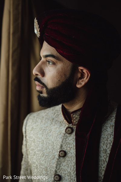 Indian groom staring at the window