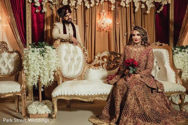 Indian bride sitting and groom standing