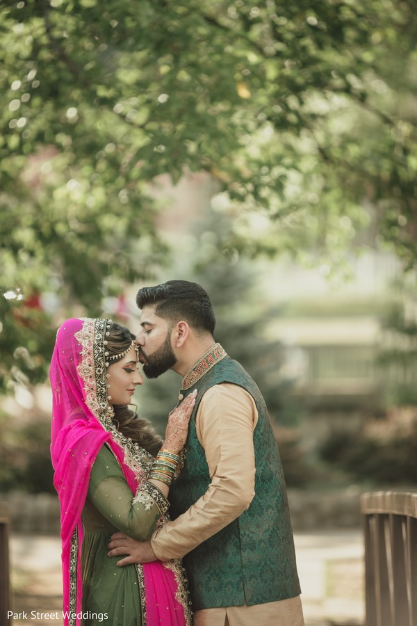 Indian couple kiss portrait.