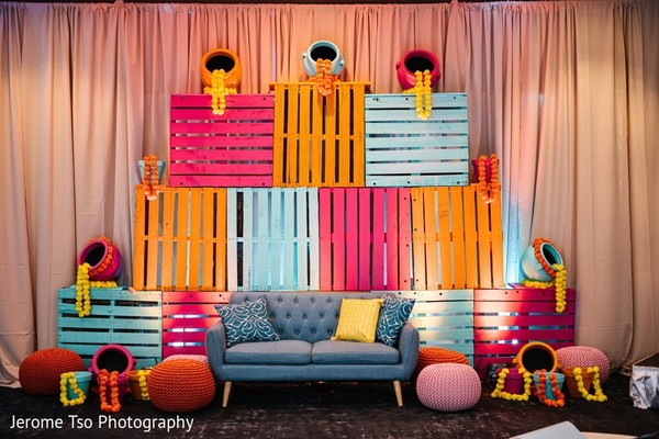 Sangeet colored pallets decorations for stage.