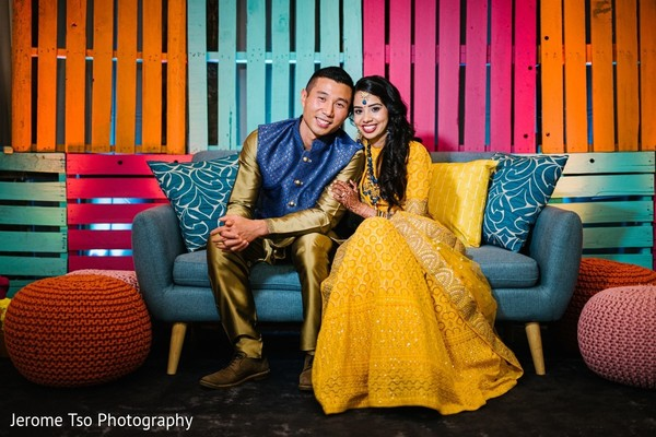 Indian couple on their gorgeous Sangeet outfits.