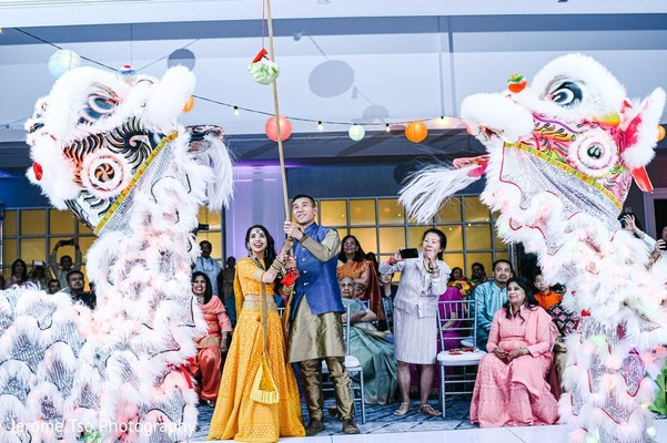 Indian couple at wedding chineese ritual.