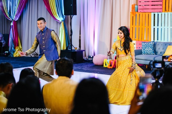 Indian couple dance performance at sangeet party.