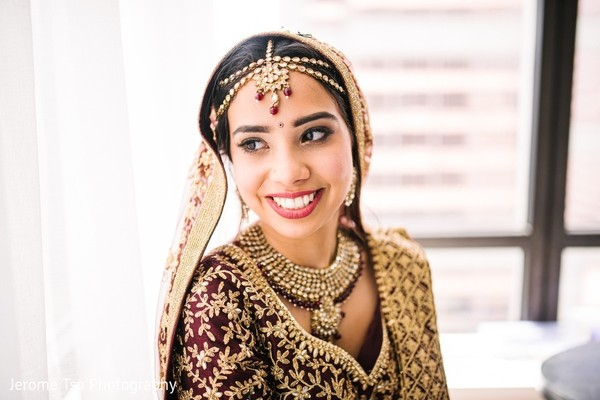 Indian bride on her wedding ceremony outfit.
