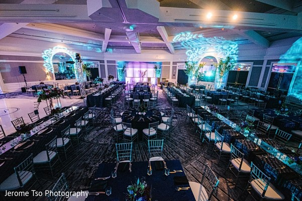Indian wedding reception round and rectangle table setup.