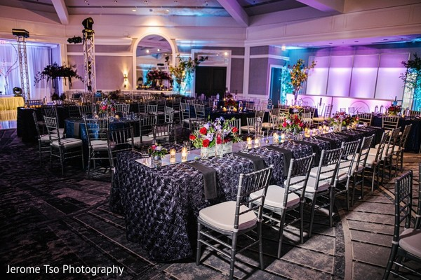 Indian wedding reception rectangle table centerpiece decor.