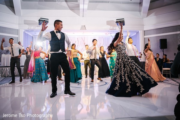 Indian couple at reception dance choreography.
