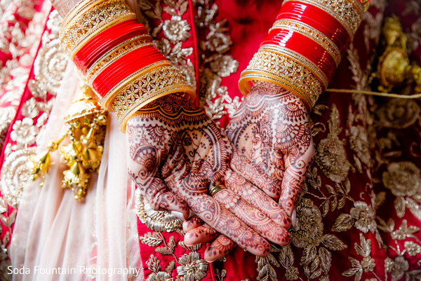 Indian birdal mehndi art and her ceremony bangles.
