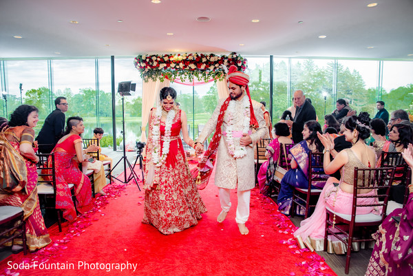 Indian couple walking down the aisle.
