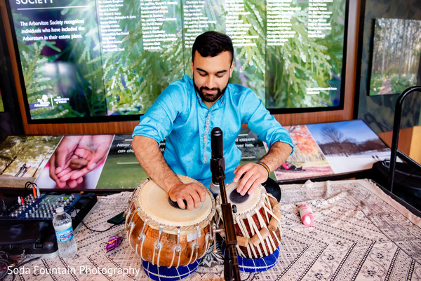 Indian wedding live dhol player.