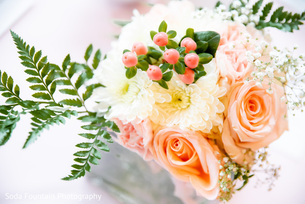 Indian wedding table peach and white flowers decor.