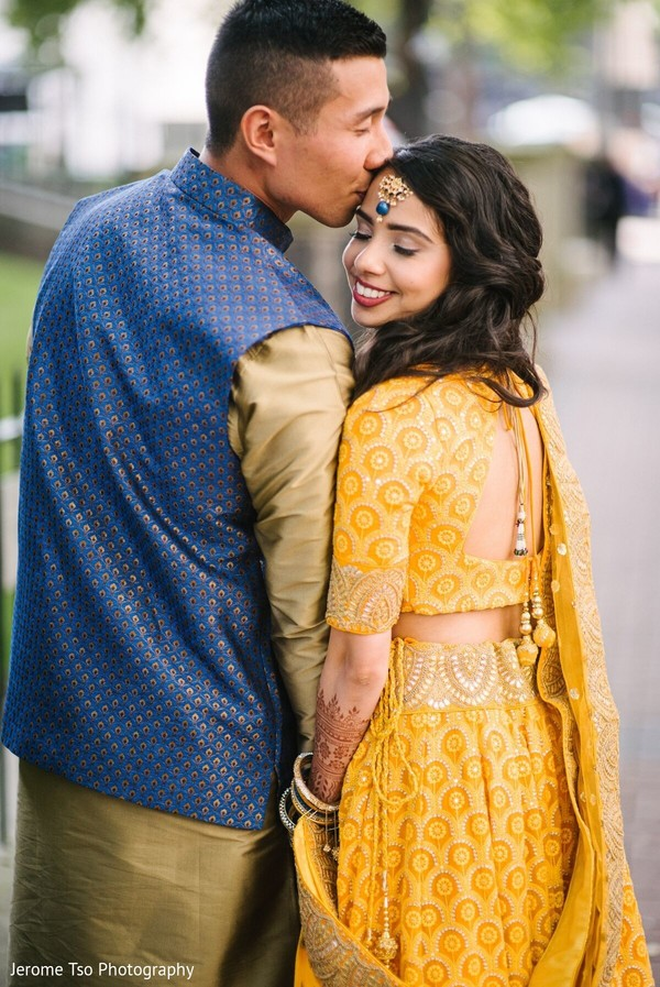 Maharani and raja posing on their sangeet outfits.