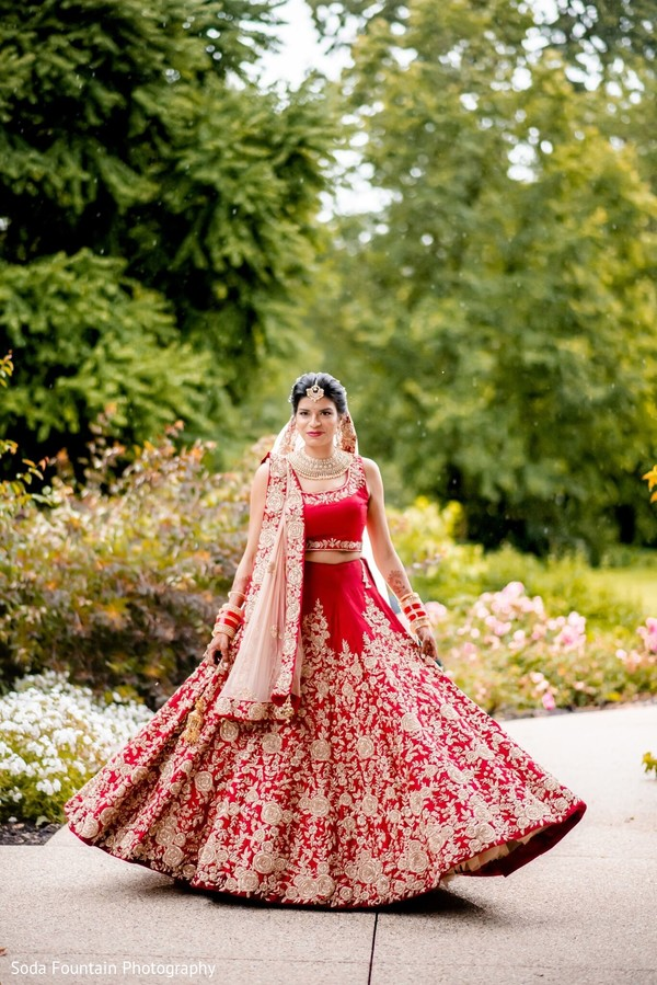 Mahrani on her red and golden ceremony lehenga.
