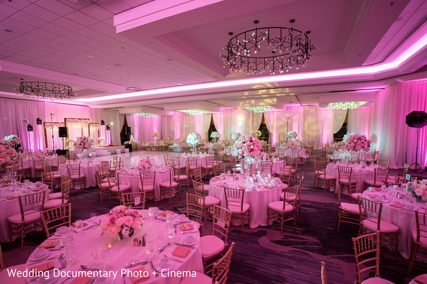 Indian wedding reception pink lights decoration.