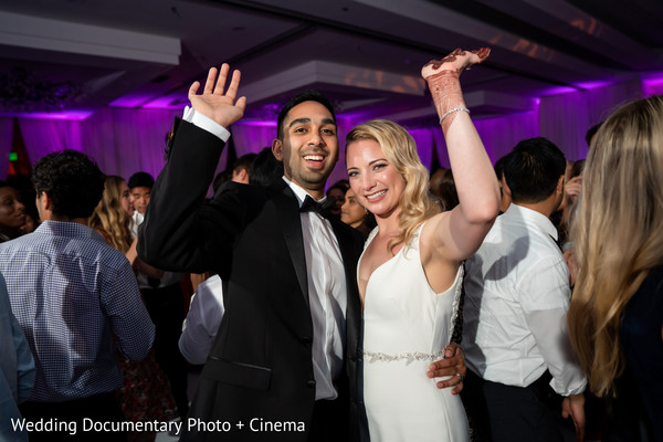 Indian couple waving at reception dance.