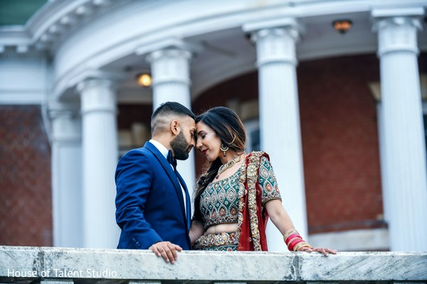 Indian newlyweds sharing a moment over a bridge