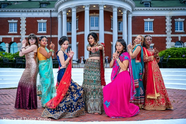 Maharani and her Indian bridesmaids striking the Charlie's Angels pose